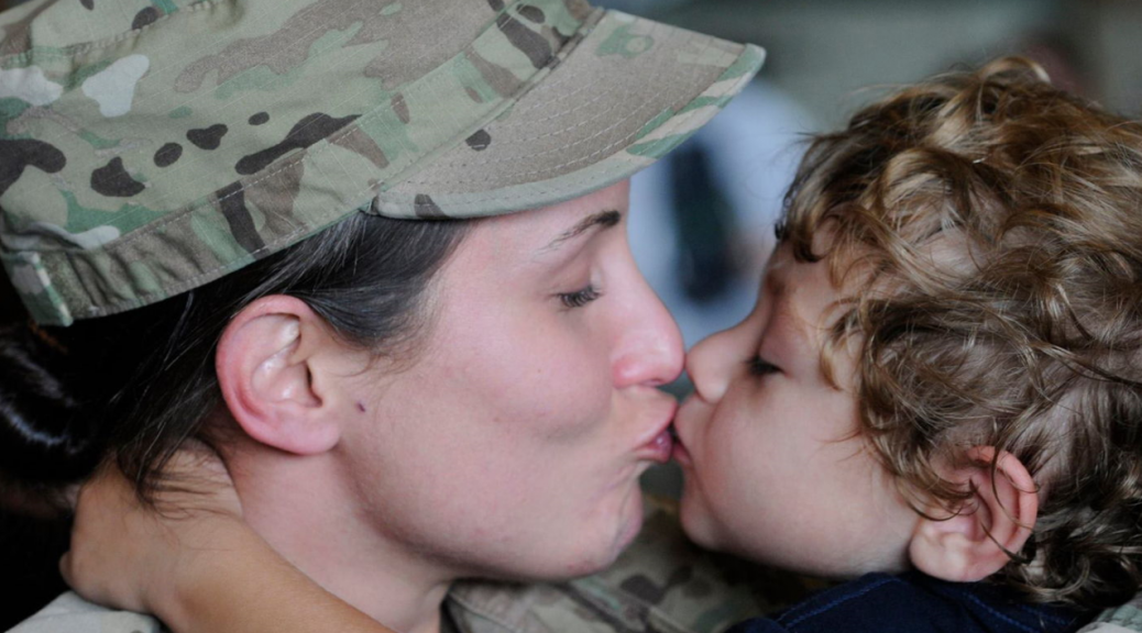 Female Veteran with her child.